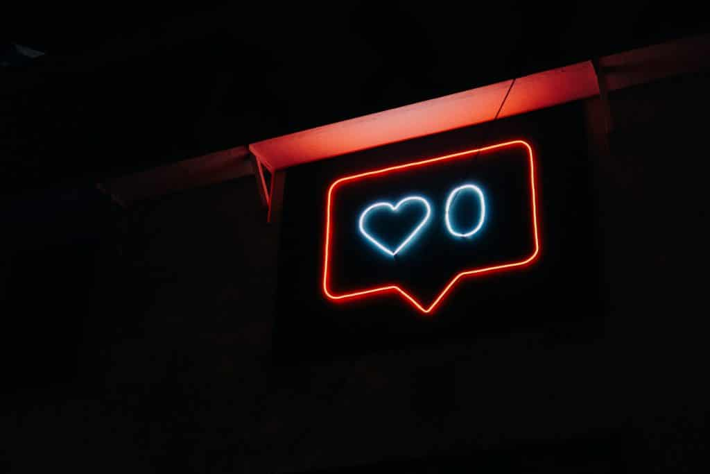 I hate social media! How do I take a break? Neon sign showing 0 likes.
