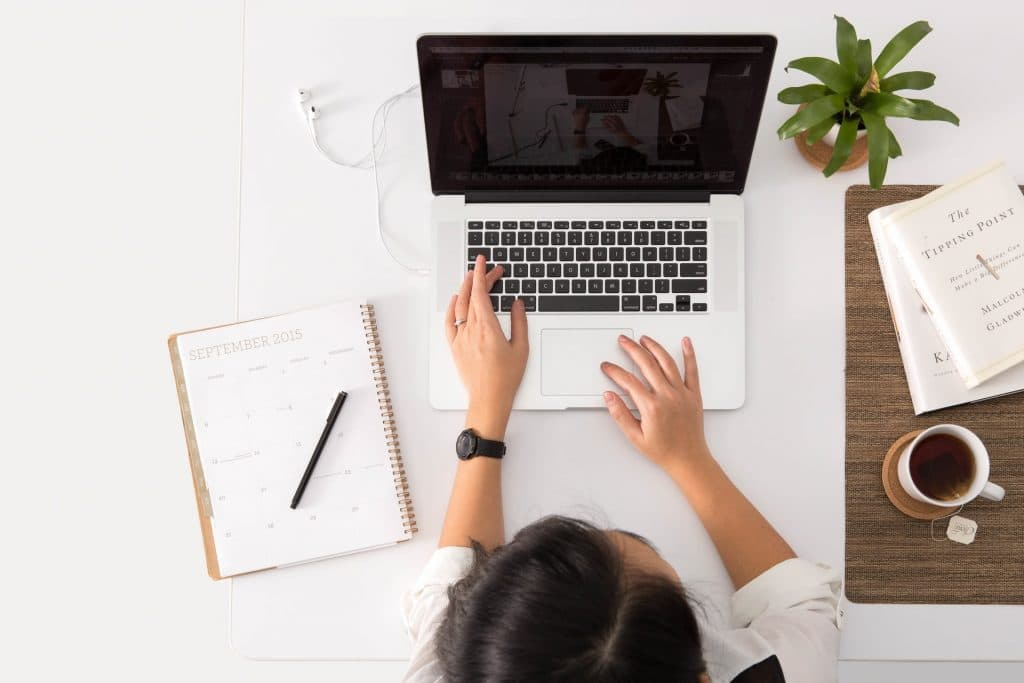 Woman working at laptop with clear desk space