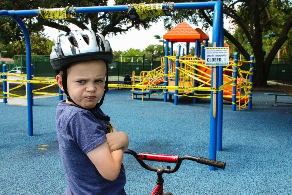 Boy on playground looking annoyed