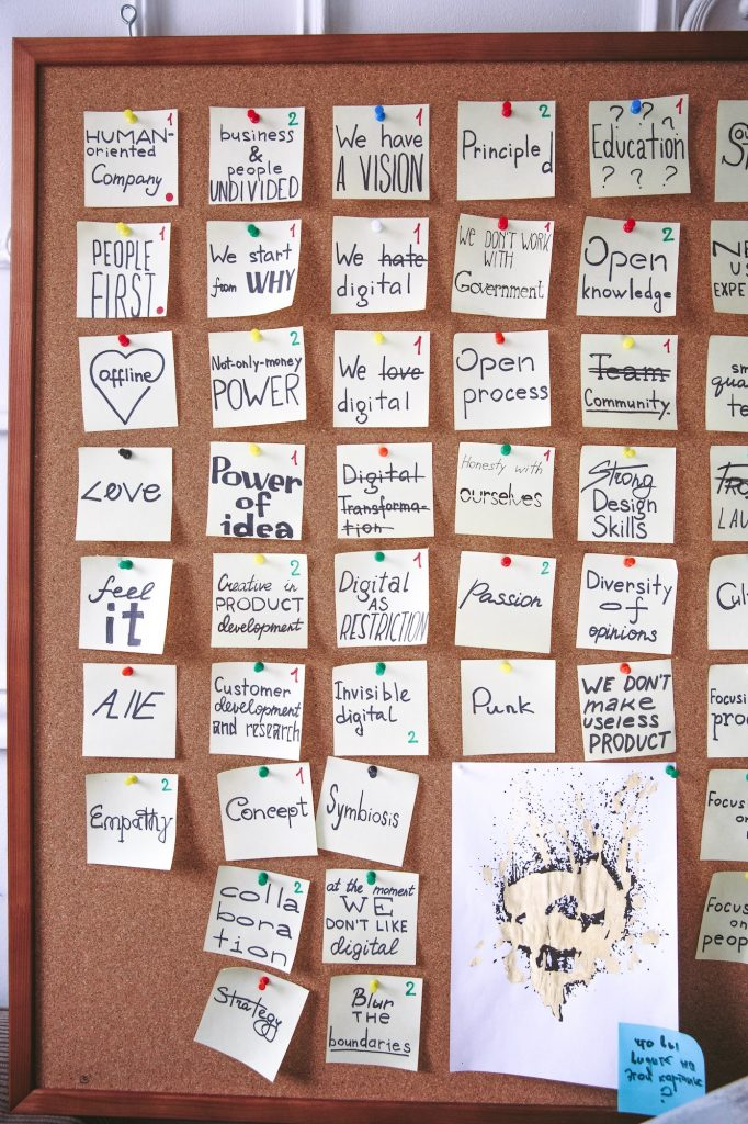 motivational and inspiring post it notes on a pinboard