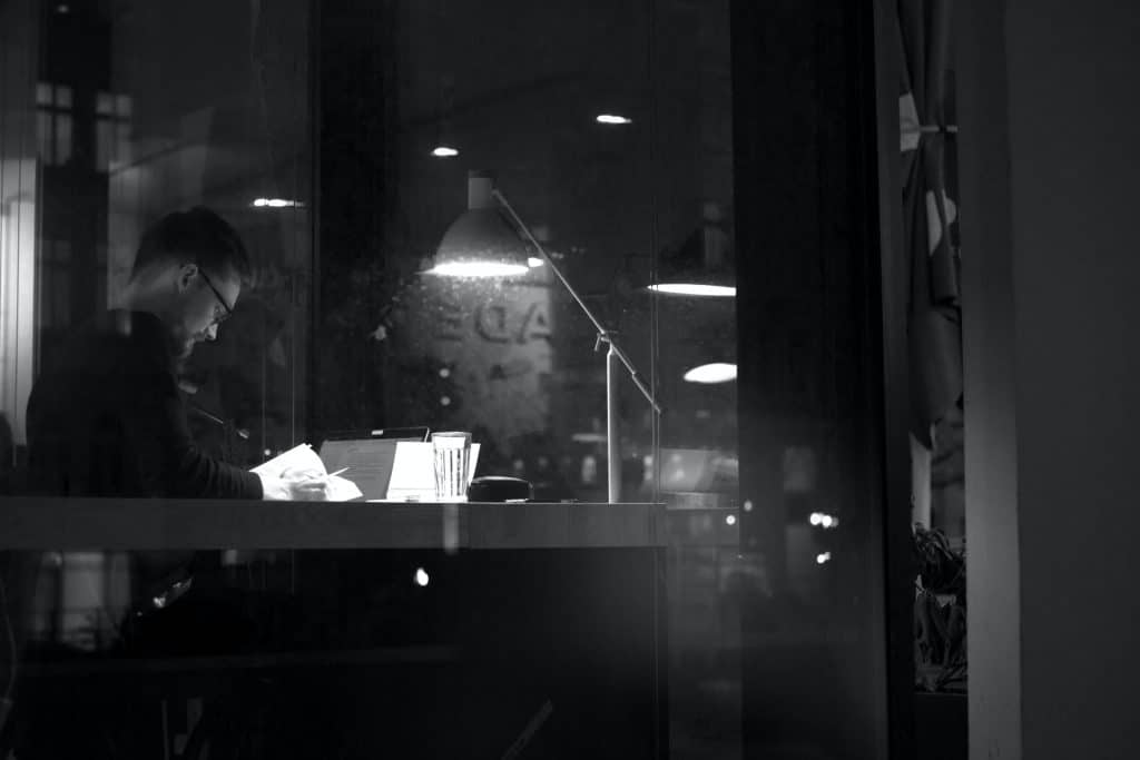 Man studying late at night in a cafe