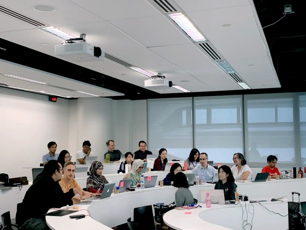 Students in a lecture hall with their laptops
