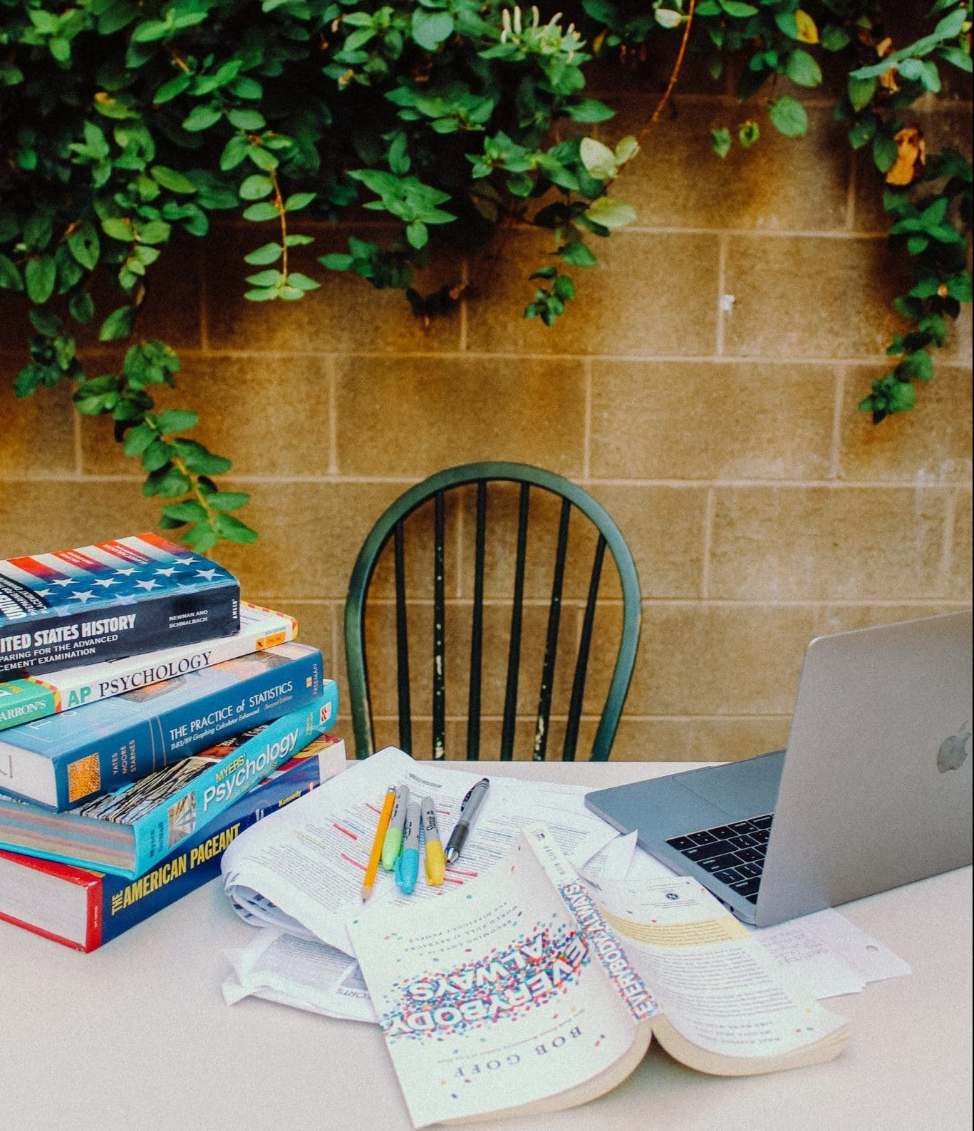 study tips - desk with textbooks, notes, and a laptop