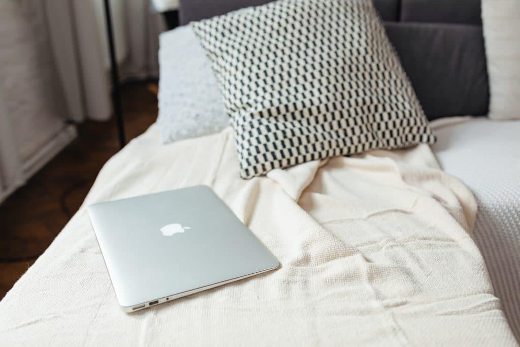 closed laptop on sofa